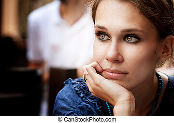 Pensive beautiful woman in the city