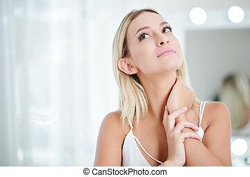 Pensive beautiful young woman