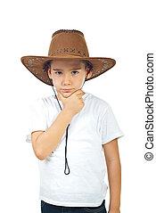 Pensive boy in cowboy hat