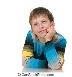 Pensive boy in striped shirt
