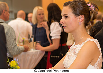 pensive bride at wedding reception