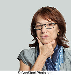 Pensive business woman in glasses thinking
