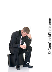 Pensive businessman - Handsome young businessman, sitting on...