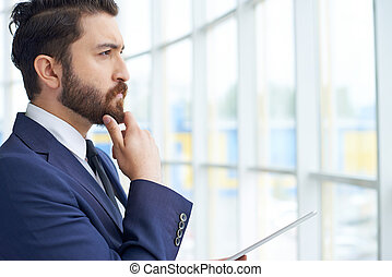 Pensive businessman - Image of young businessman with...