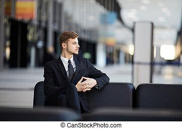 Pensive Businessman in Airport