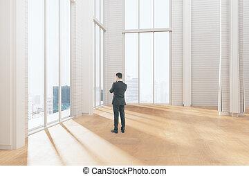 Pensive businessman in room