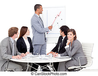 Pensive businessman reporting sales figures to his team