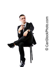 Pensive businessman sitting with cup of coffee over white background
