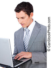 Pensive businessman using a laptop