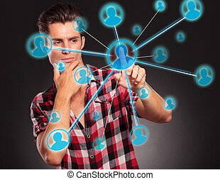man pressing on a social network button