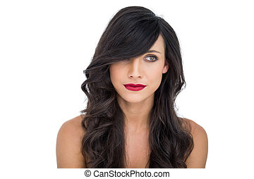 Pensive dark haired woman posing