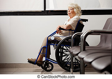 Pensive Elderly Woman On Wheelchair