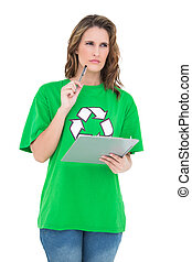Pensive environmental activist holding clipboard on white background