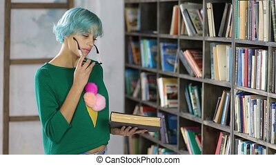 Pensive female student reading book in library