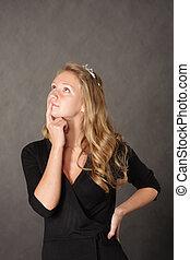 Pensive girl over dark