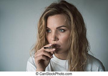 Pensive girl smoking mortal dose of nicotine - Portrait of...
