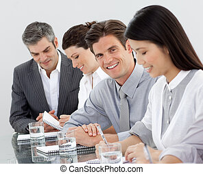 Pensive group showing diversity in a meeting looking at the camera