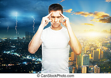 Pensive guy on city background