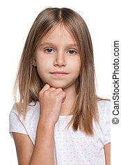 Pensive little girl against the white background