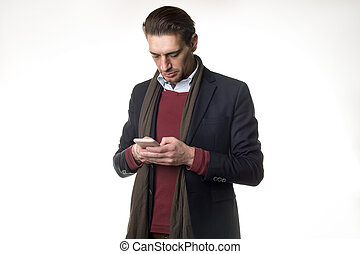 Pensive man is using mobile phone
