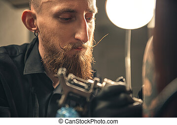 Pensive man making image on arm