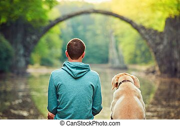 Pensive man sitting with his dog
