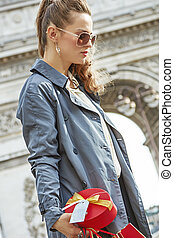 pensive modern woman with shopping bags in Paris, France