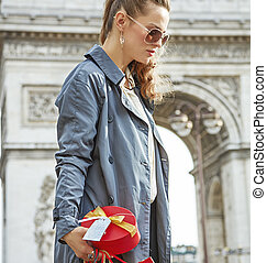 pensive modern woman with shopping bags in Paris, France -...