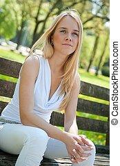 Pensive mood - woman on bench