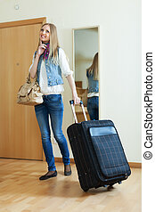 pensive positive woman with suitcase