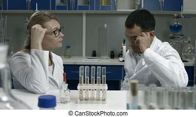 Pensive scientists thinking over bad results - Tired pensive...
