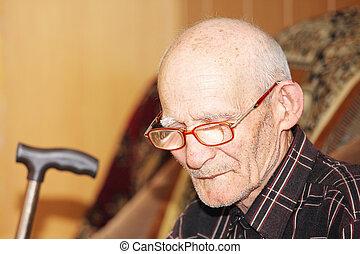 Pensive senior on sofa