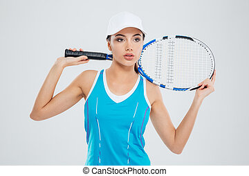 Pensive sports woman standing with tennis racquet