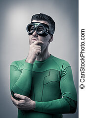 Pensive superhero with hand on chin