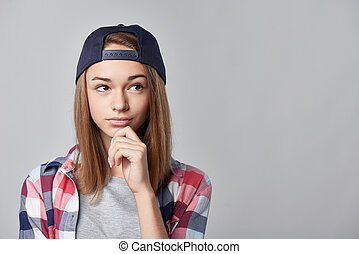 Pensive teen girl looking at copy space