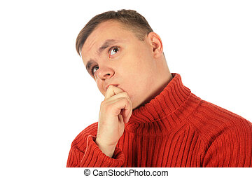 Pensive thinking young man in red sweater