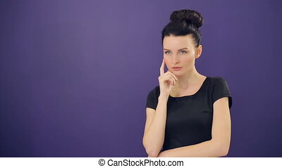 Pensive woman at lilac background - Beautiful Thinking woman...