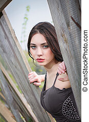 Pensive woman in gray dress