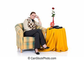 Pensive woman in sofa