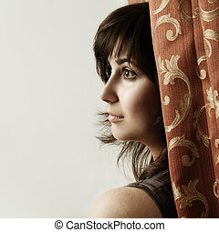 Pensive woman on background