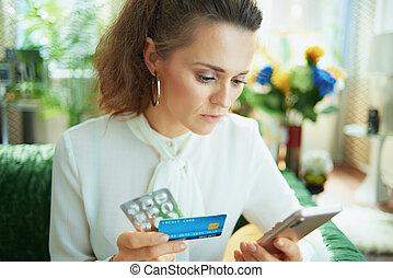pensive woman ordering medicine online