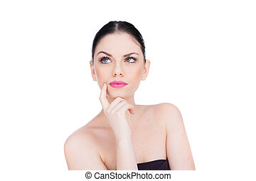 Pensive woman standing thinking