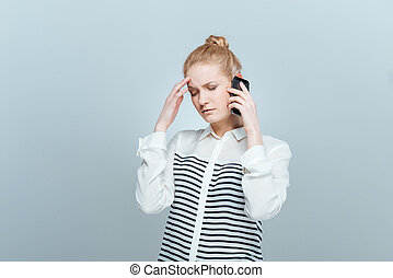 Pensive woman talking on the phone