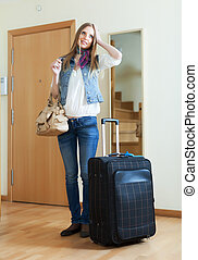 pensive woman with suitcase