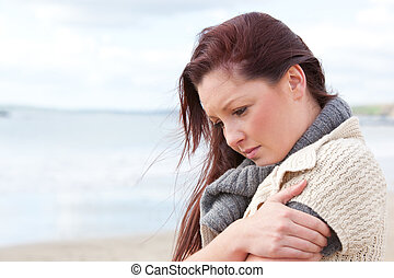 Pensive woman wondering alone