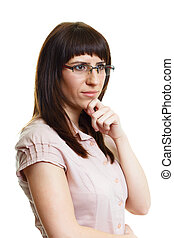Pensive young attractive girl with glasses