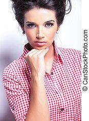 pensive young beautiful woman