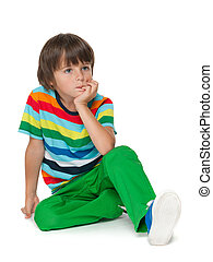 Pensive young boy in a striped shirt