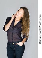 Pensive young brunette woman. - Studio portrait of gorgeous ...