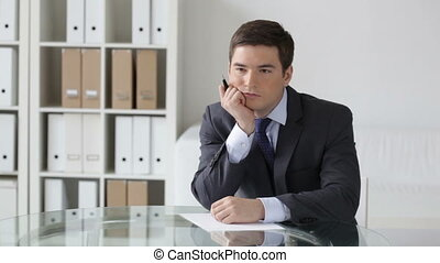 Pensive - Young businessman thinking over the text of the...